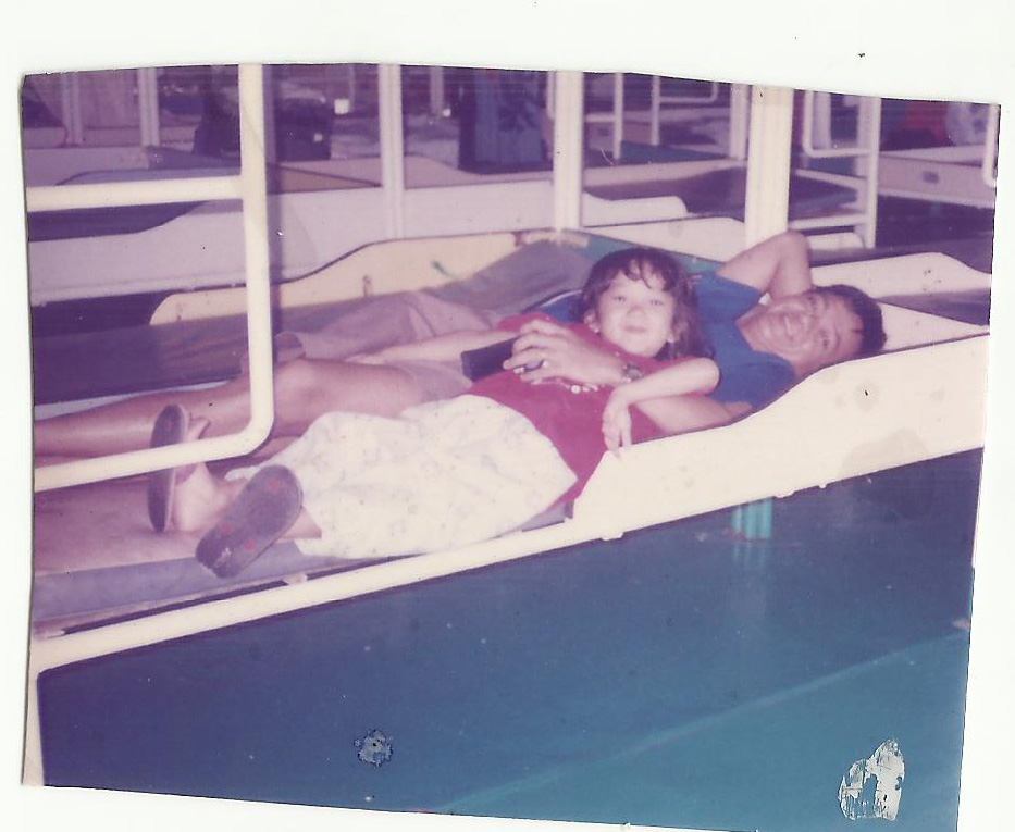 Me and tatay on a trip to Manila under a double deck bed